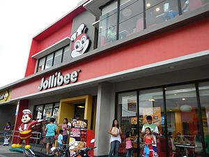 Jollibee Foods Corporation - An outlet of Jollibee, the company's primary fast food brand, in Trece Martires, Cavite.