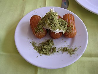 Tulumba - Image: Tulumba with kaymak and pistachio