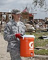 U.S. Air Force Senior Airman Clay Coppage, assigned to the 34th Combat Communications Squadron at Tinker Air Force Base, Okla., assists in the cleanup effort May 25, 2013, in Moore, Okla 130525-Z-VF620-4096.jpg