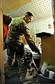 U.S. Air Force Staff Sgt. Max Soto, a military dog handler assigned to the 455th Expeditionary Security Forces Group, searches the living quarters of third-country national employees, or workers who are not U.S 130530-F-IW762-016.jpg
