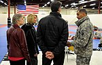 U.S. Army Maj. Gen. Michael X. Garrett, explains the Army's Combatives Training to distinguished guests, from left, Cheri Spink, the executive director of 130425-A-ZX807-002.jpg