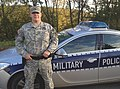 U.S. Army Military Police officer standing in front of his Patrol Car in Germany.jpg