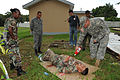 U.S. Army Sgt. Trey Carter, right, a nurse, and combat medic, with 94th Combat Support Hospital pours fake blood on a volunteer, prior to a combat medic exercise, with Belize Defence Force and Belize Disaster 100830-A-CL600-136.jpg