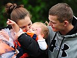 U.S. Army Spc. Douglas McCreery, with the 109th Transportation Company, 2nd Engineer Brigade, and his wife Michelle kiss a friend's baby during the brigade's special event, called Arctic Trailblazer 120810-F-LX370-474.jpg