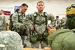 U.S. Army paratroopers with the 1st Brigade Combat Team, 82nd Airborne Division, take turns buddy-rigging T-10 parachutes during Operation Federal Eagle, an annual joint airborne operation held between U.S 130418-A-RV385-004.jpg