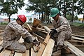 U.S. Marine Corps Lance Cpl. Jaicinio Jarrettsoto, left, and Pfc. Ismael Moctezumadelalanza, both with the 9th Engineer Support Battalion, 3rd Marine Logistics Group, III Marine Expeditionary Force, remove nails 130725-M-DR618-065.jpg