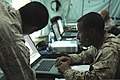 U.S. Marine Corps Lance Cpl. Judah B. Collins, right, a data systems specialist with the 14th Marine Regiment, works in the Joint Operations Center in Agadir, Morocco, April 8, 2012, during African Lion 2012 120408-A-QD330-050.jpg