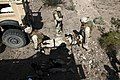 U.S. Marines with Transportation Support Company, Combat Logistics Regiment 2, 2nd Marine Logistics Group, undergo realistic scenarios while executing a combat logistics patrol exercise during Enhanced Mojave 120922-M-KS710-038.jpg
