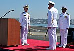 U.S. Navy Capt. Christopher Bolt, right, salutes Capt. Thom Burke during a change of command ceremony aboard the aircraft carrier USS Ronald Reagan (CVN 76) in San Diego Aug. 13, 2013 130813-N-AV746-370.jpg