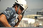 U.S. Navy Ensign Lashondra Phillips, ship's boatswain, relays a message down to the quarterdeck of the amphibious command ship USS Blue Ridge (LCC 19) as the ship prepares to arrive in Hakata, Japan, Aug. 10 120810-N-QI421-432.jpg