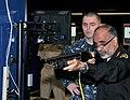 U.S. Navy Machinist's Mate 1st Class Jordan Melancon, center, a facilitator for for the USS Missouri Small Arms Marksmanship Trainer (SAMT), watches Saudi navy Rear Adm. Dawi Mohammed Saad al-Otaibi fire a 121107-N-IK959-538.jpg