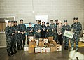 U.S. Sailors assigned to the aircraft carrier USS Abraham Lincoln (CVN 72) pose for a photo with a portion of the food items they donated to the Virginia Peninsula Food Bank Nov. 25, 2013, in Newport News, Va 131125-N-CH132-107.jpg