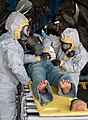 U.S. Soldiers attired in chemical suits decontaminate a simulated casualty during Vibrant Response 11 110316-A-TJ359-003.jpg