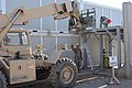 U.S. Soldiers with the 760th Engineer Company, 489th Engineer Battalion, attached to the U.S. Central Command Materiel Recovery Element of the 82nd Sustainment Brigade, disassemble a staircase from a relocatable 131111-A-MU632-779.jpg