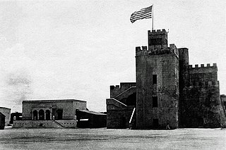 The flag of the United States waving over Ozama Fortress during the U.S. occupation of the Dominican Republic, c. 1922