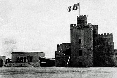 The flag of the United States waving over Ozama Fortress during the U.S. occupation of the Dominican Republic, c. 1922 USMC Fortaleza Ozama 1922 restored.jpg