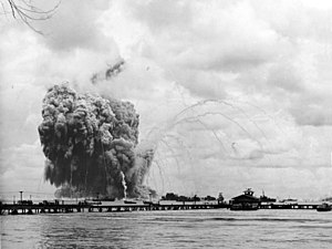 USS Mount Hood (AE-11) - Mount Hood explodes: the smoke trails are left by fragments ejected by the explosion.