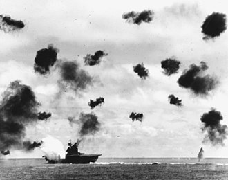 USS Yorktown (CV-5) - Yorktown is hit on the port side, amidships, by a Japanese Type 91 aerial torpedo during the mid-afternoon attack by planes from the carrier Hiryu.
