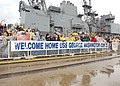 US Navy 021220-N-4374S-001 Family members and friends anxiously await the arrival of USS George Washington.jpg