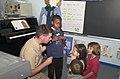 US Navy 030401-N-5996C-003 Lt. Cmdr. Mark Flynn a doctor at U.S. Naval Hospital Rota explains the heartbeat to first graders.jpg