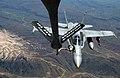 US Navy 030411-N-0780F-089 An F-A-18 Hornet strike fighter embarked aboard USS Harry S. Truman (CVN 75) receives fuel from an Air National Guard Boeing KC-135 Stratotanker.jpg
