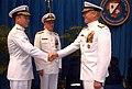 US Navy 031216-N-0021M-001 Rear Adm. Kevin M. Quinn (left) is congratulated by Seventh Fleet Commander, Vice Adm. Robert F. Willard, after Quinn's assumption of command.jpg
