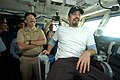 US Navy 031222-N-9742R-002 Aboard USS Enterprise (CVN 65), Commanding Officer Capt. Eric C. Neidlinger, left, shares a laugh with Academy Award winning actor Ben Affleck, who enjoys the view from the Captain's chair.jpg