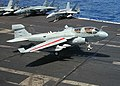 """US Navy 040722-N-7535G-010 An EA-6B """"Prowler"""" assigned to the """"Zappers"""" of Electronic Attack Squadron One Three Zero (VAQ-130) comes in for an arrested landing aboard USS Harry S. Truman (CVN 75).jpg"""