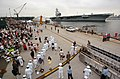 US Navy 040723-N-4142G-175 Family and friends anxiously wait on board Naval Air Station North Island, as USS Ronald Reagan (CVN 76) prepares to moor at the stations pier facilities.jpg