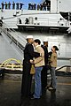 US Navy 041206-N-8505J-089 Sailors say goodbye before boarding the amphibious transport dock USS Duluth (LPD 6) for a scheduled deployment to the Western Pacific.jpg