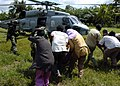 US Navy 050104-N-6817C-120 Indonesian civilians rush to load their injured into an SH-60B Seahawk helicopter.jpg