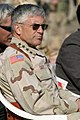 US Navy 051130-M-2819S-108 Commanding General, Multi-National Forces-Iraq, U.S. Army Gen. George Casey, sits and listens to speeches made at a flag raising ceremony.jpg