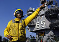 US Navy 060314-N-9742R-003 Chief Aviation Boatswain's Mate Jimmy Candelaria, directs aircraft on the flight deck aboard the nuclear-powered aircraft carrier USS Enterprise (CVN 65).jpg