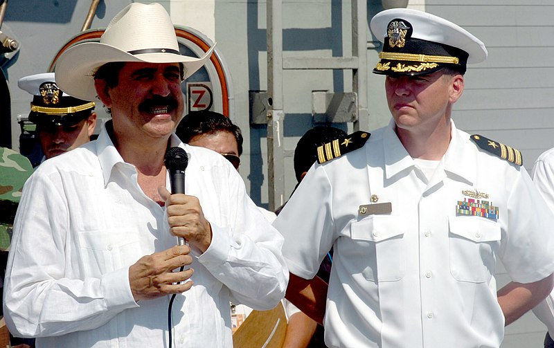 Happier Days: Manuel Zelaya, in his trademark sombrero, on board the USS Underwood in 2006.