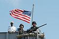 US Navy 060606-N-1688B-030 Sailors man a .50-caliber gun mount as the amphibious transport dock USS Nashville (LPD 13).jpg