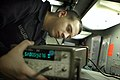 US Navy 070110-N-1332Y-085 Aviation Electronics Technician Airman Brandon Mallard, from Fremont, Calif., reviews calibration procedures for a cable test unit in USS Kitty Hawk (CV 63) Calibration Lab.jpg
