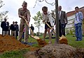 US Navy 070426-N-0502M-167 Commandant of Naval District Washington Rear Adm. Terence McKnight and Naval Sea Systems Command (NAVSEA) Executive Director Sharie Bourbeau place the first few shovels of dirt onto a young pink, flow.jpg