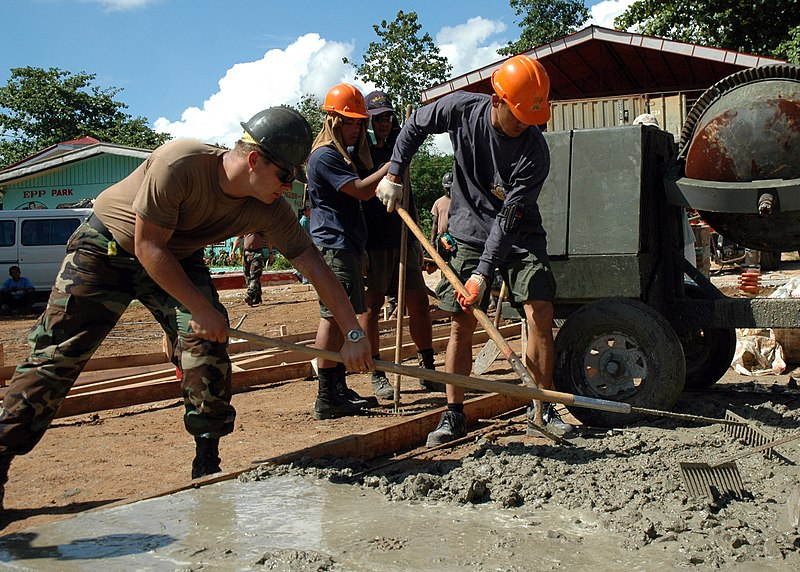 File:US Navy 070604-N-2296G-051 Builder 2nd Class Michael Schneider (left) attached to Naval Mobile Construction Battalion (NMCB) 7, rakes concrete with his Philippines Navy seabee counterpart, Fireman 1st Class Builder Elmer Ang.jpg