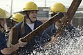 US Navy 070627-N-8148A-157 A damage control team from USS Theodore Roosevelt (CVN 71) prepares to enter a flooded training compartment during the 5th Annual Damage Control (DC) Olympics at Farrier Fire Fighting School.jpg