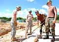 US Navy 070905-N-1120L-056 Army and Navy construction personnel work together to shovel soil around a post at a Material Liaison Office project site on Camp Shields, as part of joint training exercise.jpg