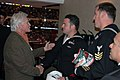 US Navy 071004-N-7006N-002 Navy divers assigned to Mobile Diving and Salvage Unit (MDSU) 2, meet Minnesota Wild owner Bob Naegle during the Wild's season opening NHL hockey game against the Chicago Blackhawks.jpg