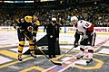 US Navy 071104-N-8110K-003 Command Master Chief Sandra Huffman, assigned to the guided-missile destroyer USS Sampson (DDG 102), drops the ceremonial first puck.jpg