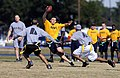 US Navy 071201-N-5328N-586 Quarterback and Cryptologic Technician (Technical) 1st Class Jakob Chauvin runs through a gauntlet of Army defenders during the fifth annual CID Corry Station Flag Football Game at Corry Station.jpg