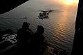 US Navy 080119-F-1644L-089 Air Force HC-130 loadmasters Senior Airman Daniel Sullivan and Senior Airman Renea Zachary communicate with a CH-53 Sea Stallion during in-air refueling operations.jpg