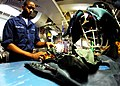 US Navy 080912-N-2183K-109 Aircrew Survival Equipmentman Airman Marquise Thompson inspects flotation devices aboard the amphibious assault ship USS Peleliu (LHA 5).jpg