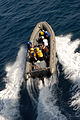 US Navy 081006-N-3610L-018 A Rigid Hull Inflatable Boat (RHIB) team assigned to the Nimitz-class aircraft carrier USS Ronald Reagan (CVN 76) races out to sea during a training evolution.jpg