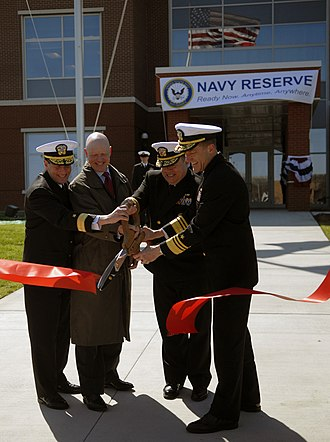 United States Navy Reserve - U.S. Navy admirals participate in the ribbon cutting ceremony for the opening of the new Navy Reserve Forces Command Headquarters at Naval Support Activity Norfolk.