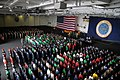 US Navy 090523-N-1786N-056 Sailors aboard the aircraft carrier USS Nimitz (CVN 68) stand at attention for a rifle volley during a memorial service in the hangar bay.jpg