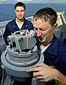 US Navy 090605-N-5345W-134 Midshipmen 2nd Class Alex Guffey, an NROTC student at Auburn University, receives instructions from Lt. j.g. Jonathan Pastell on how to take a bearing reading.jpg