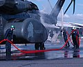US Navy 090714-N-3581D-100 Sailors perform a freshwater rinse on an MH-53E Sea Dragon helicopter after a flight at Rockhampton Airport in Queensland, Australia.jpg